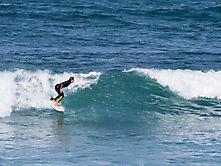 Surferin in Caleta de Famara, Lanzarote