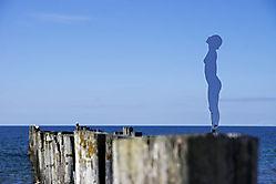 Dame am Meer